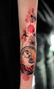 Nature Themed Watercolor Arm Tattoo