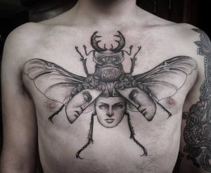 Two Faced Beetle Chest Tattoo