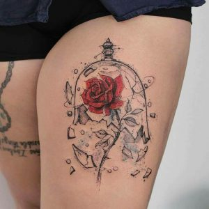 Shattered Glass With Rose Thigh Tattoo