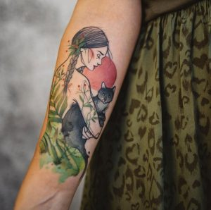 Woman With A Cat Forearm Tattoo