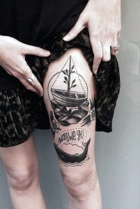 Boat On A Rock Thigh Tattoo
