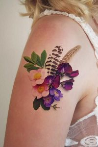 Realistic Flowers And Feathers Arm Tattoo
