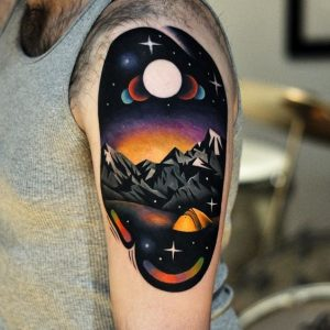 Space Infused Landscape Arm Tattoo