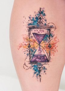 Space Themed Hourglass Thigh Tattoo