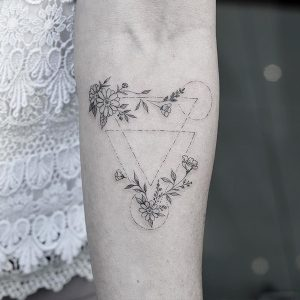 Geometric Dashed Lines With Flowers Forearm Tattoo