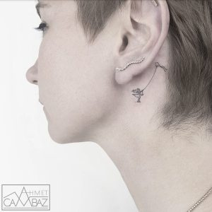 Girl With A Kite Behind The Ear Tattoo