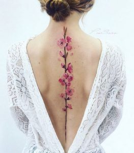 Blooming Pink Flowers Spine Tattoo