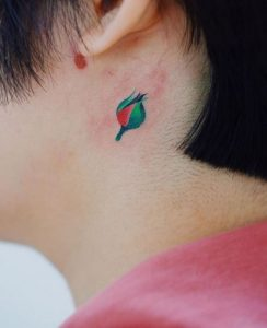 Floral Bud Behind The Ear Tattoo