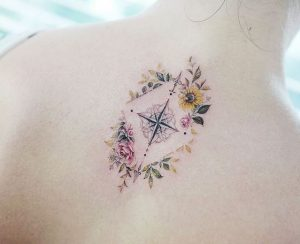 Floral Compass Back Tattoo