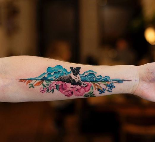 Dog In A Floral Setting Forearm Tattoo