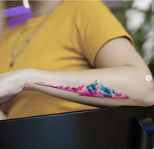 Pink And Blue Mountains Arm Tattoo