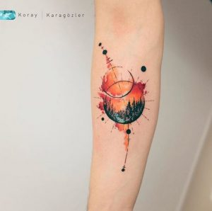 Watercolor Sunset Forearm Tattoo